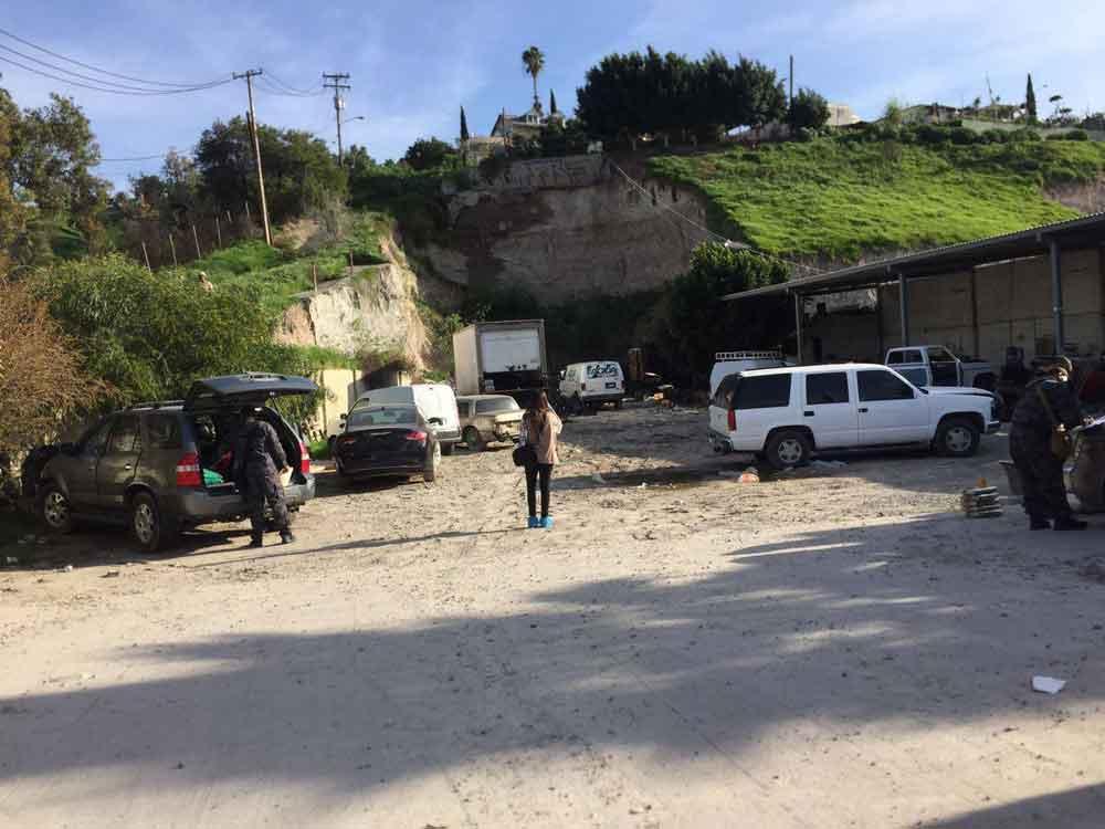 Localizan más de media tonelada de droga y 18 vehículos tras cateo en Tijuana