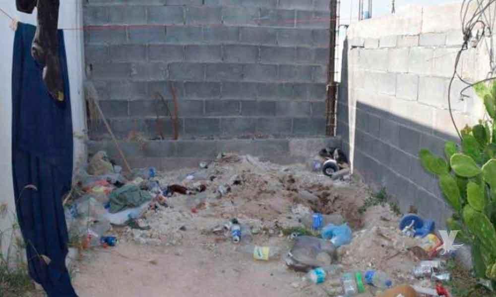 Dueño fue a cobrarle la renta a su inquilino, lo halló muerto y semienterrado en el patio