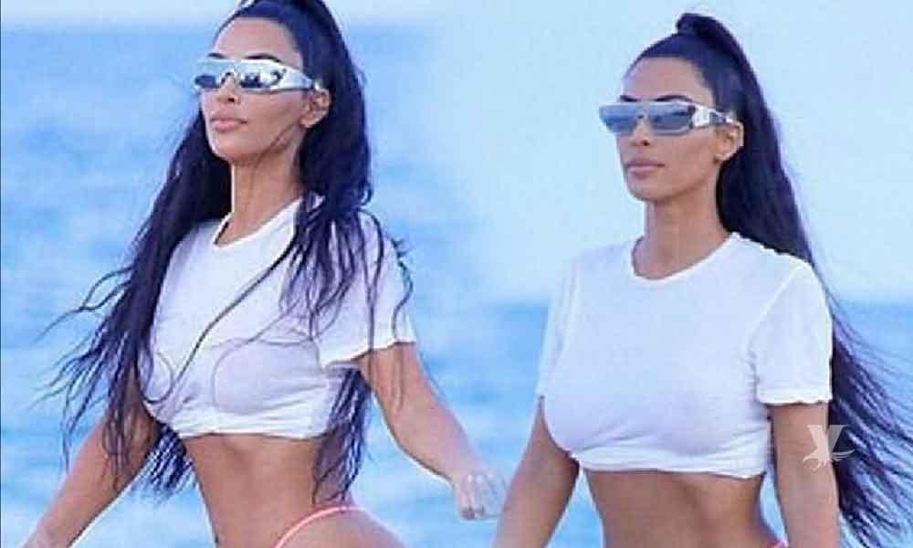 Kim Kardashian se olvida de la celulitis en la playa y lo demuestra con diminuta tanga de hilo