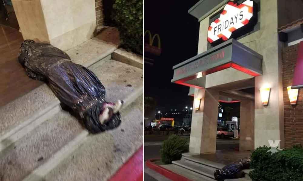 """TGI Fridays Tijuana decora por Halloween su restaurante con un """"embolsado"""" y los comensales enfurecen"""