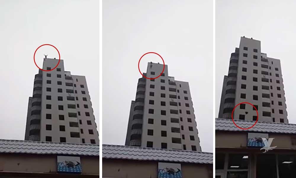 (VIDEO) Muere menor de 15 años frente a su madre al saltar de edificio con paracaídas casero