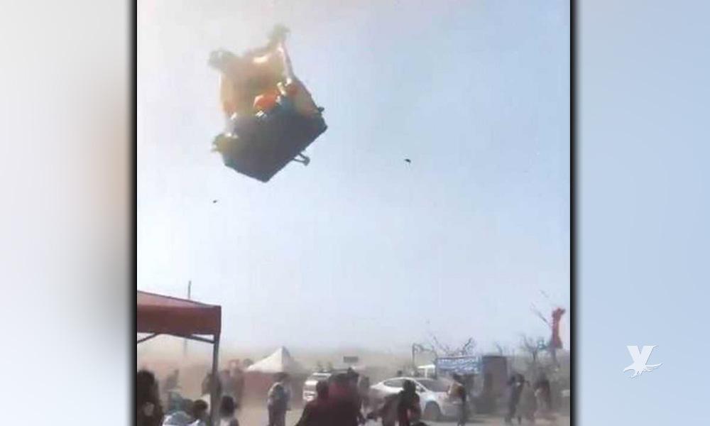 Tornado levanta juego inflable por unos 150 metros con niños dentro
