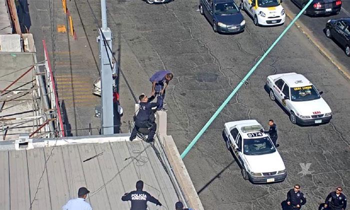 Cámaras de seguridad captan a hombre queriendo saltar de un techo