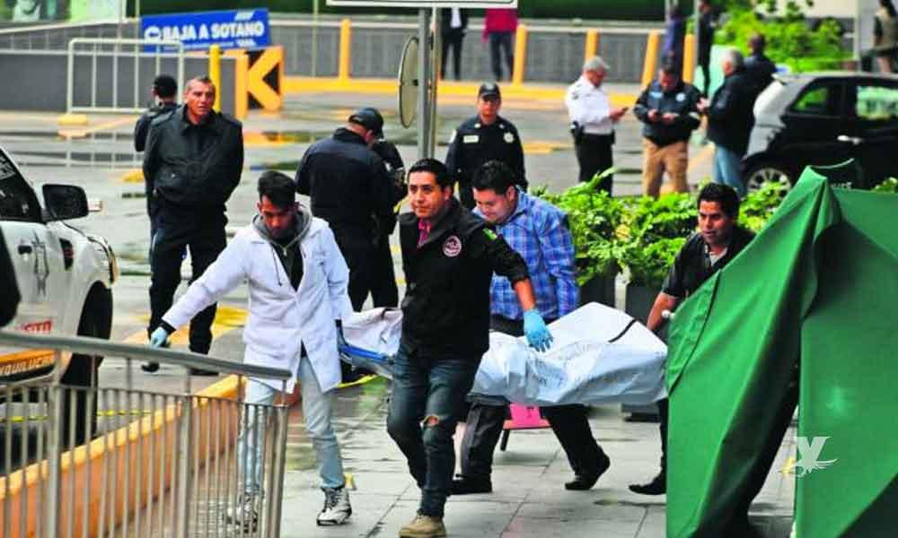 Policía es acribillado durante un asalto a un cuentahabiente