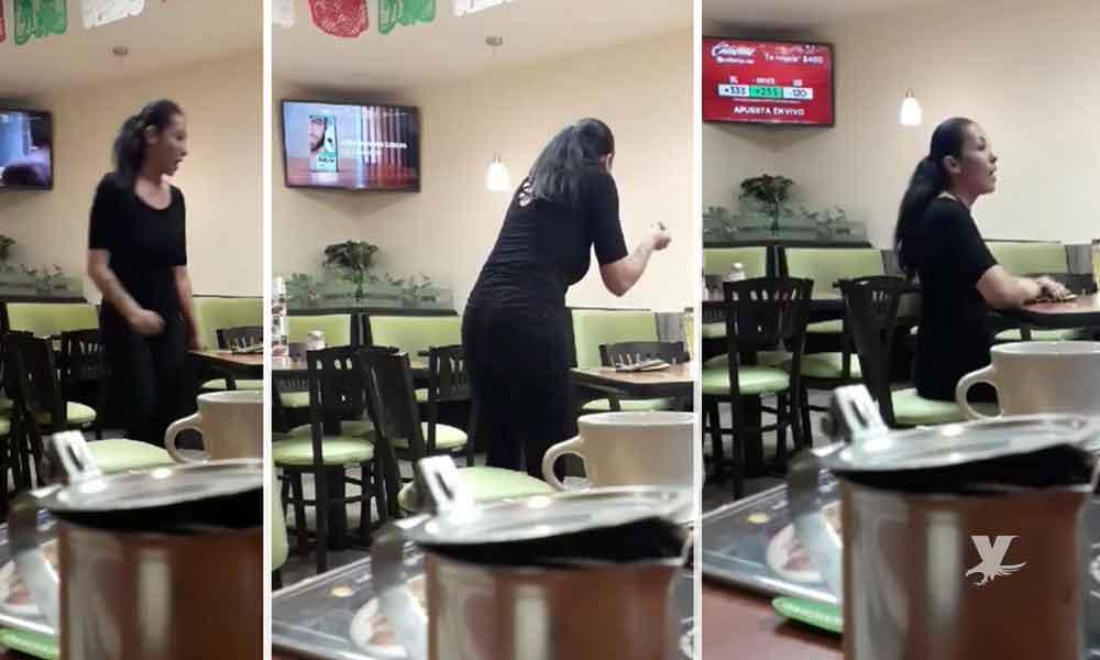 (VIDEO) Mujer es captada discutiendo sola al interior de un restaurante
