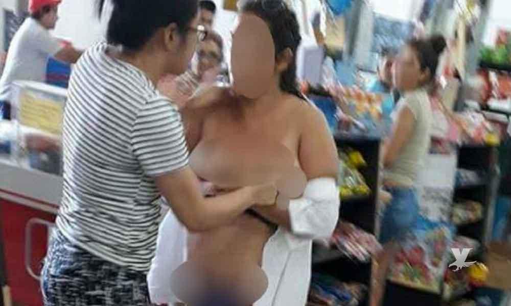 (VIDEO) Mujer se desnuda en centro comercial para demostrar que no se robo nada
