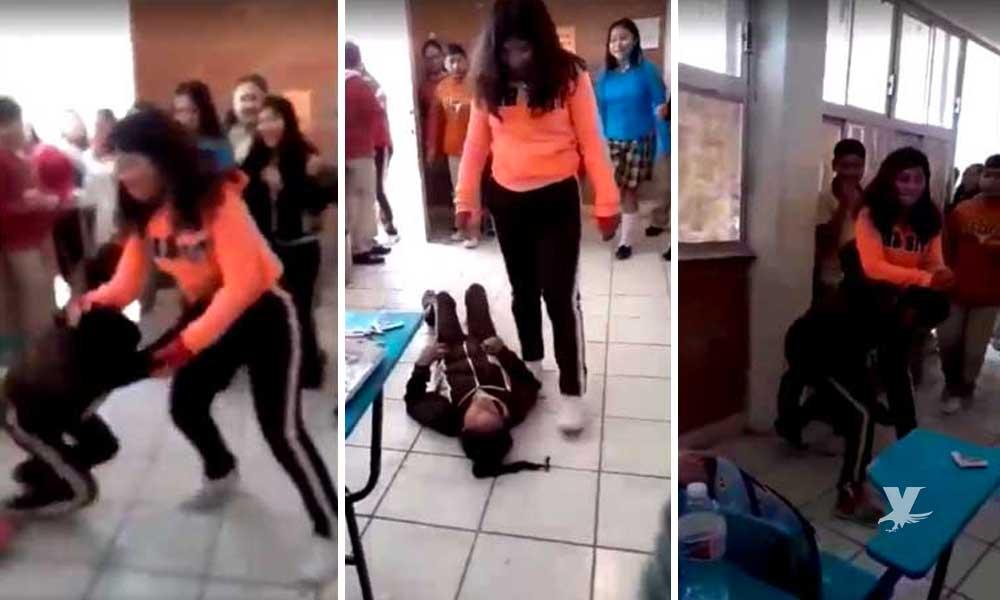 """(VIDEO) Alumnas pelean al interior de salón de clases, director se burla de la estudiante """"perdedora"""""""